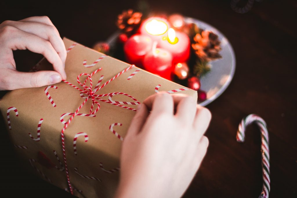 person opening a gift